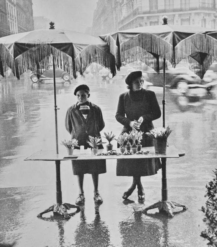 Selling flowers in the rain, Paris, ca. 1950's