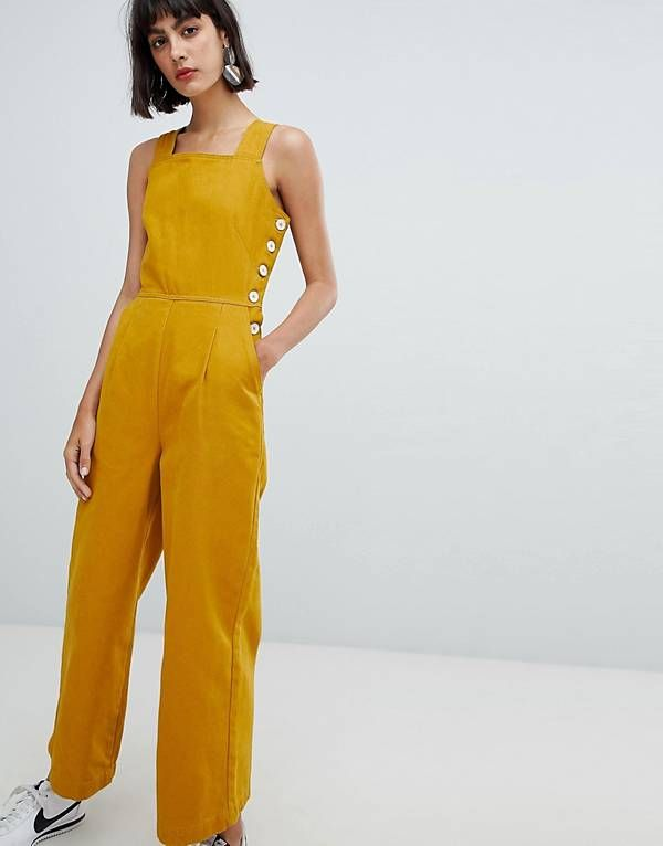 abe227de62f ASOS DESIGN denim jumpsuit with side buttons in mustard