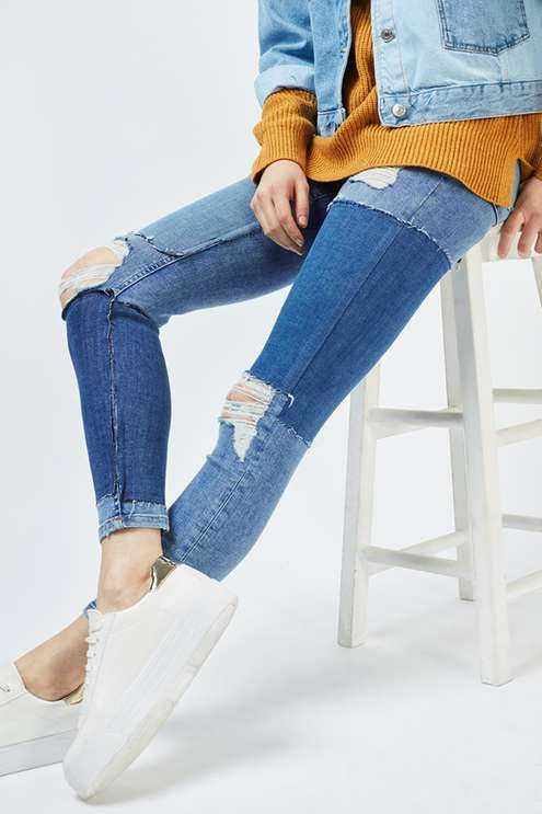 In a perennially cool high-waisted fit, the MOTO Jamie is the original rock n' roll skinny jean that we fell in love with all those years ago. Crafted from a super-stretchy grey cotton blend for our signature soft denim feel, the iconic style includes multiple pockets, a top button fly, mixed panels and ripped knees for an added edge. #Topsop