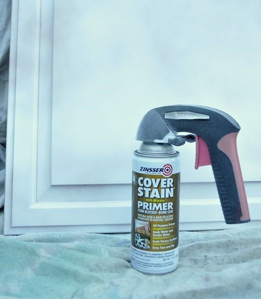 spray primer painting cabinets girl