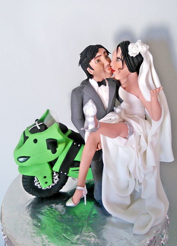 /bride and groom on bike wedding cake topper