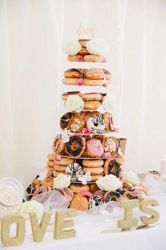 Krispy Kreme wedding cake donut tower                                                                                                                                                                                 More