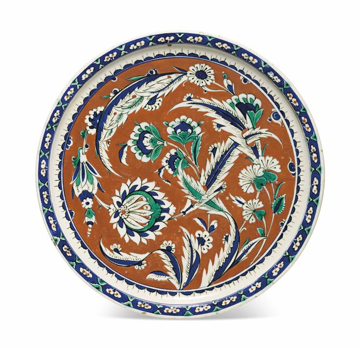 A RARE RED-GROUND IZNIK POTTERY DISH OTTOMAN TURKEY, CIRCA 1585-90