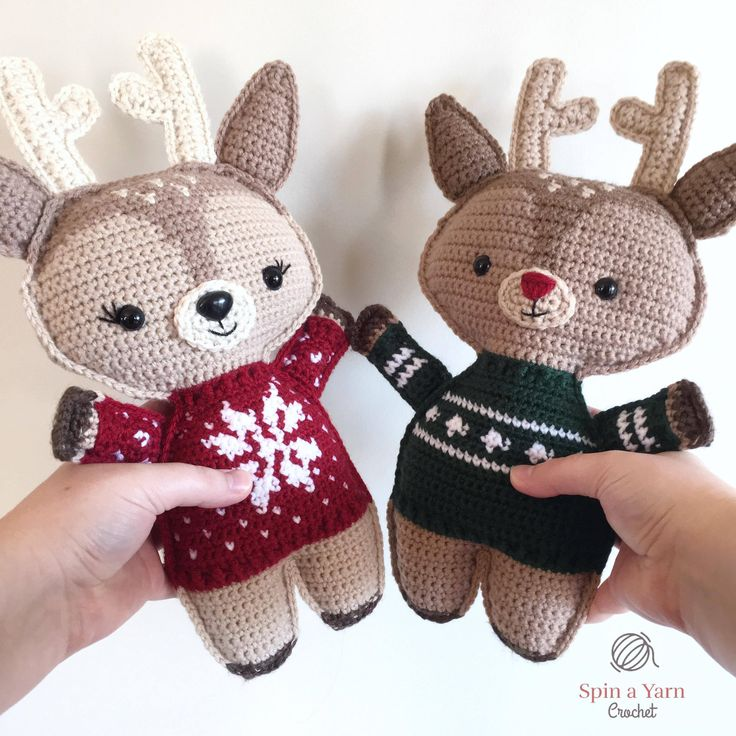 Reindeer wearing red and green sweaters #crochet