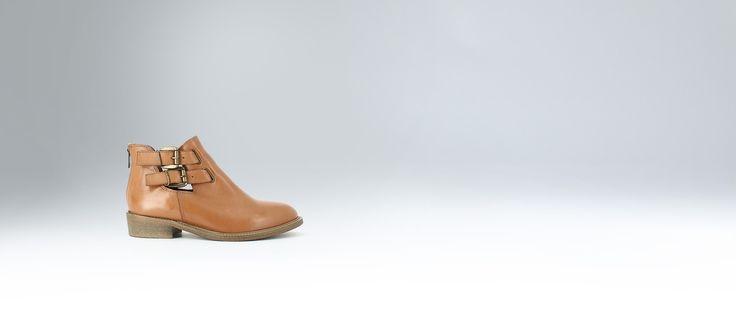 Boots plates ajourées en cuir cognac