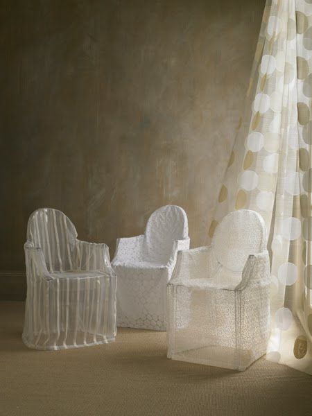 Sheer slipcovers on ghost chairs