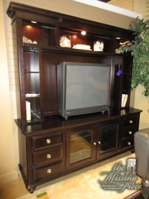 "Transitional style entertainment cabinet in a dark finish. There are shelves down either side and drawers at the base. Offers plenty of storage. It is lit as well. Measures 76""wide x 20""deep x 79""high.  Arrived: Friday November 4th, 2016"