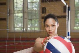 Volleyball drills for middle school girls are designed to improve their form and technique as well as their agility on the court. While individual skills can be improved through drills, other drills work on improving team chemistry and communication. Volleyball drills range from service drills to spiking drills.