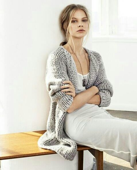 Minimal + Chic . Simple white dress under a thick grey oversized cardigan.