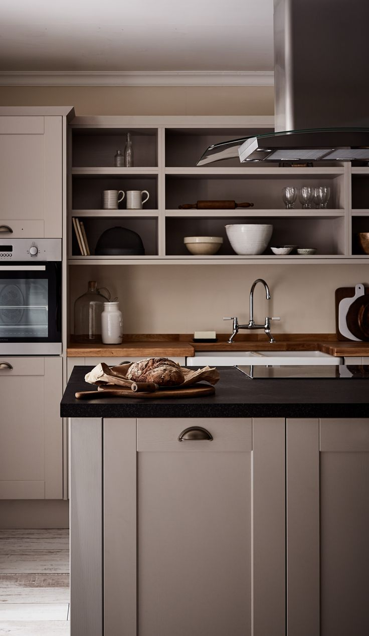 It is worth considering the mix and match of contrasting work surfaces with the Shaker kitchen. The warmth of our Oak Block worktop combined with the deep tones of our Blackstone worktop gives a contemporary twist to the classic Shaker look. Burford Grained Sone Kitchen from The Shaker Collection by Howdens Joinery