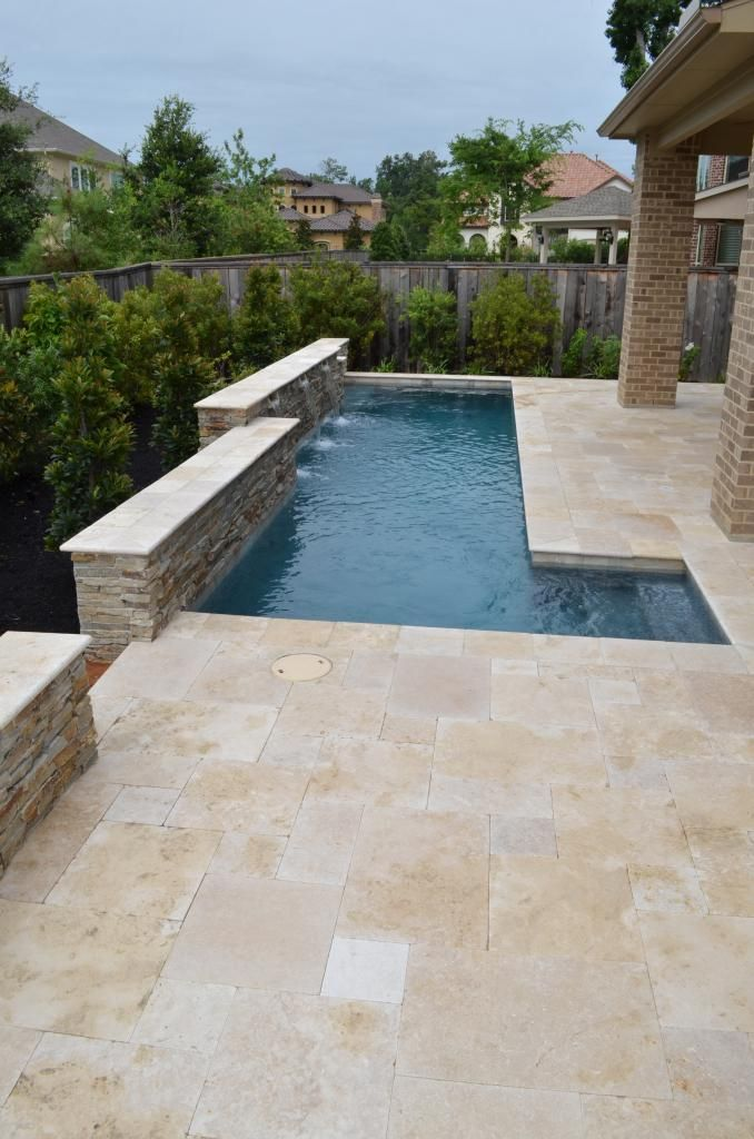 Gorgeous decking - travertine, love how it rolls into the pool