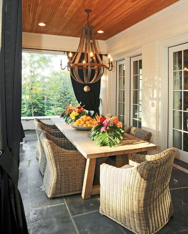 The chandelier above the dining table is made from reclaimed French oak wine barrels staves and hoops.