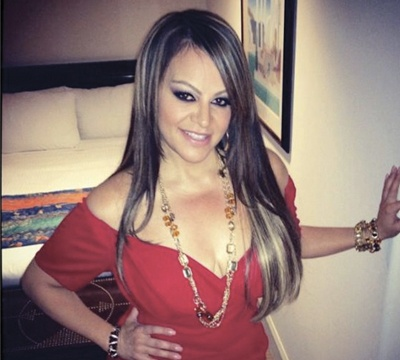 SMH: Jenni Rivera Sued By Family Of Pilot Of Plane Crash!...... this hair and color!!!!!