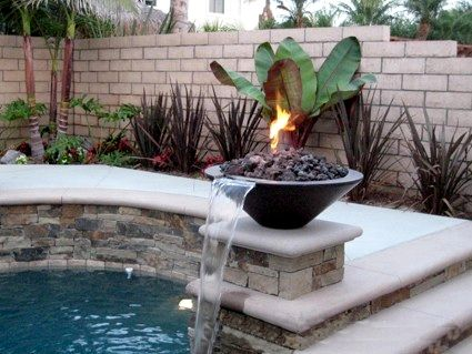water feature with fire pits  pool  Pool water features Fire pit backyard Backyard water feature