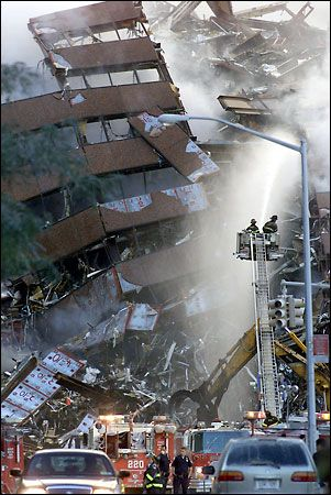 Firefighters watering the pile that was WTC 7.