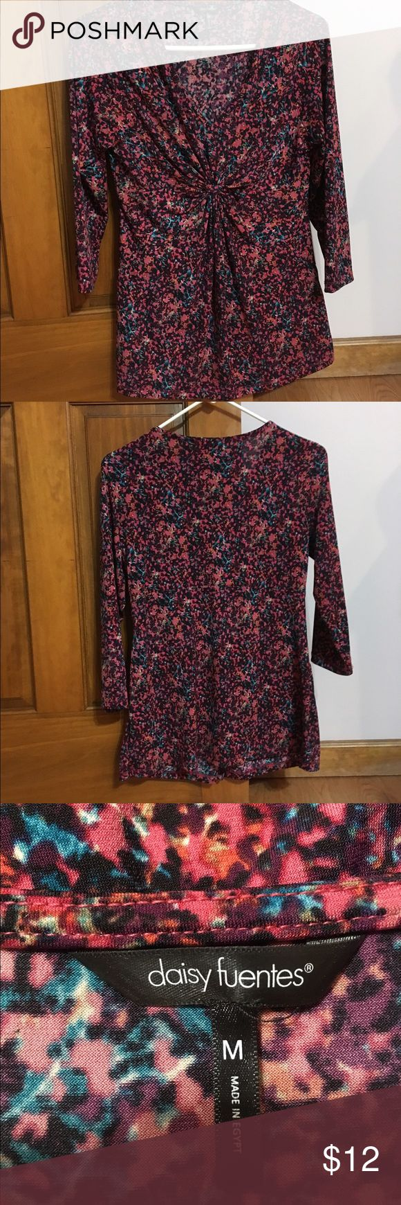 Daisy Fuentes Top This is an adorable top by Daisy Fuentes.  The pictures show the gathering in the front at a closer view.  This top is in great condition and shows no visible wear on it. Daisy Fuentes Tops Tunics