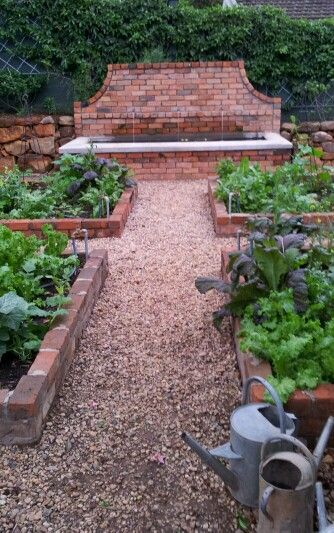 Brick raised beds, gravel path, possibly I don't need a walled fountain...