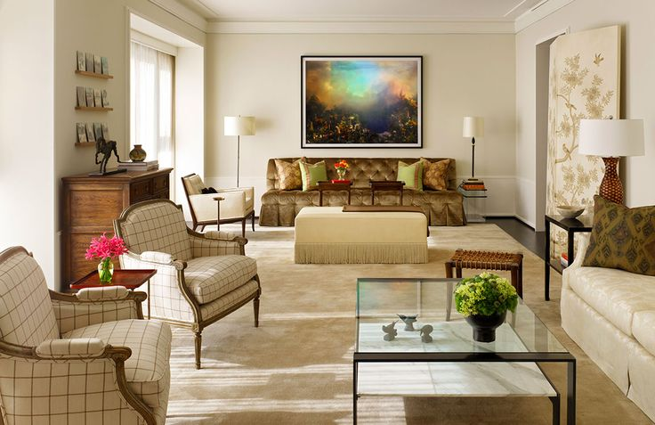 For this large condominium in Chicago's Gold Coast neighborhood, design firm Vincere used a neutral backdrop to complement the home's modern art and strong architecture, creating a timeless, sophisticated look.