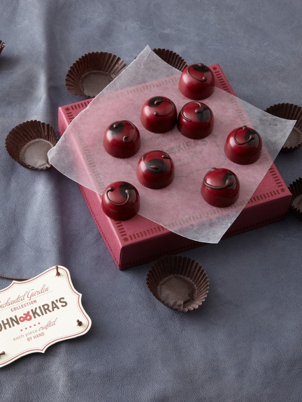 A dried Montmorency sour cherry, 62 percent Valrhona chocolate ganache and a touch of brandy all meld into one delicious (and gorgeous) bite.