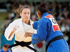 Team USA's Marti Malloy (left) faces off against Colombia's Yandinys Amaris…