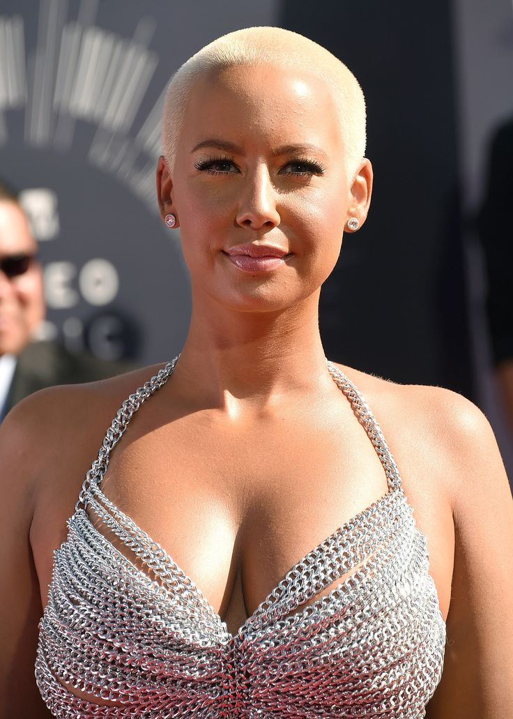 Amber Rose rocks her signature bleached shaved hair with long lashes and a glossy pout.