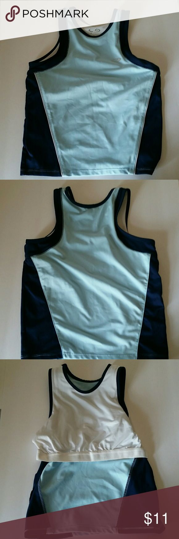 "Champion workout top with built in sports bra Size small champion workout top with built in sports bra. Measures appox 16.25"" long  from back. Appox 14"" bust. Approx 13"" waist. Navy& light blue colors Champion Tops Tank Tops"