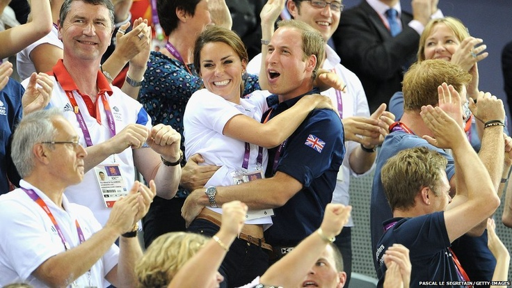 The Duke and Duchess of Cambridge embrace after Philip Hindes, Jason Kenny and Sir Chris Hoy of Great Britain win the gold and set a new world record in the Men's Team Sprint Track Cycling in the London 2012 Olympic Games.