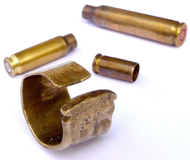 This ring is made from an empty bullet casing. It has been carefully hammered flat and bent. See more at www.etsy.com/shop/therockapparel