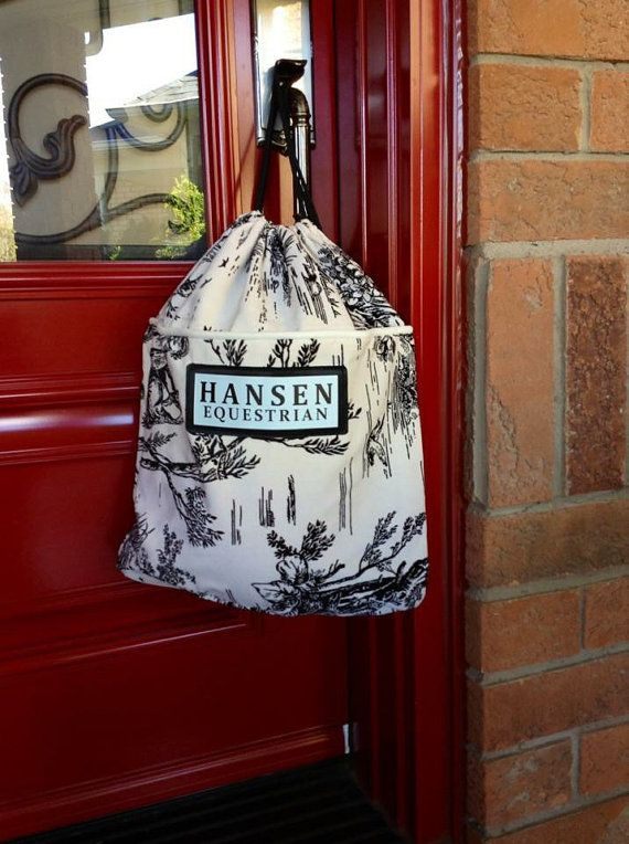 Hansen Helmet Bags are the perfect tote for around the barn, horse show or even out on the street. This simple bag can be used for your helmet, gloves, spurs or even as a purse.  They are available in all of our micro-fibre patters, they are machine washable, and come with a draw string closure that creates the ability to be worn like a back pack or hung up easily in your locker or tack trunk.