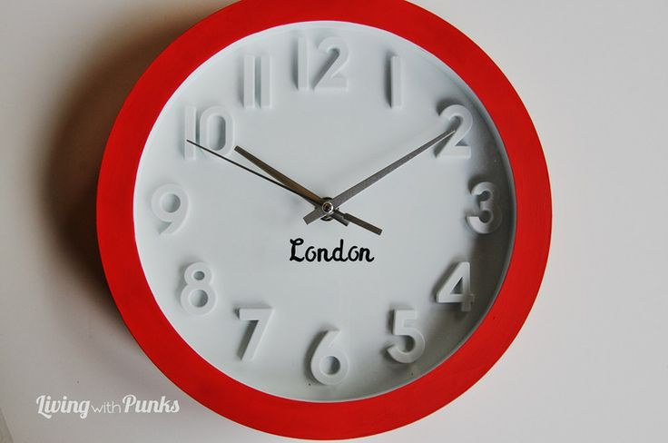 Have a line of clocks with different time zones with a name of a big city from each time zone painted on it.