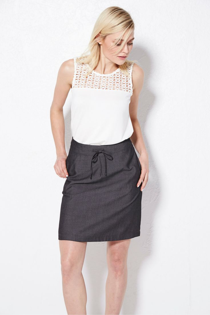 A modern take on a classic white top- the eyelet detail in this neckline can't be missed! #summerfashion #looksforless