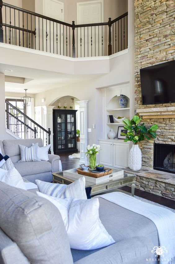 Love the color scheme of this living room, and the deck style railing that allows you to see whats going on from the second floor!
