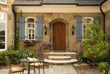 I love this stone, pretty door, and detail above doors and windows