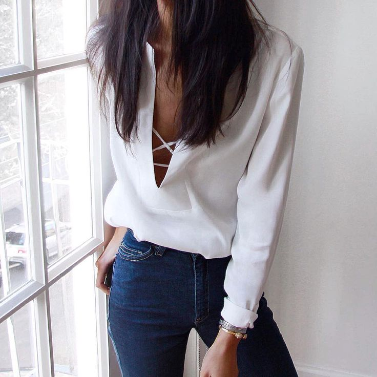 This white blouse replaces the need for a necklace. The lace up adds the spark to an otherwise plain outfit.