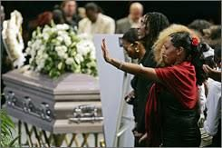 Mia Turner, far right, and Ronnie Turner, third from right, children of music legend Ike Turner, stand next to his coffin as they are blessed during a memorial service at the City of Refuge church in Gardena, Calif. Friday. Turner, a member of the Rock and Roll Hall of Fame and former husband of music legend Tina Turner, died Dec. 12 at 76. Damian Dovarganes / AP