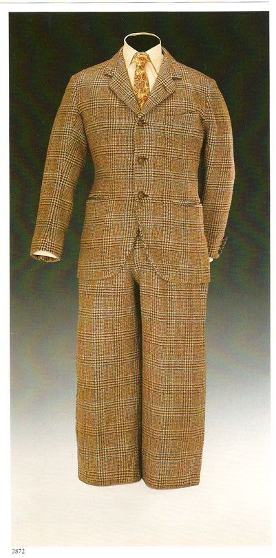 "Man's checked sports suit with removable blue cotton plus-four linings, by Scholte of London (jacket) and Forster & Sons (""stalking trousers"" -- modified plus-fours), British, 1923. Worn by Edward, Prince of Wales."