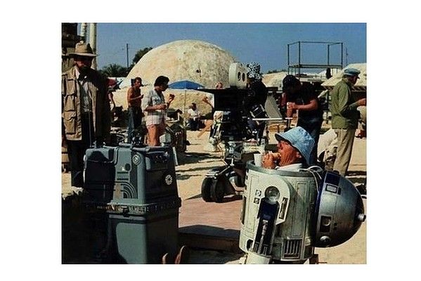 Kenny Baker (who plays R2D2) has a lunch break on the Star Wars set.