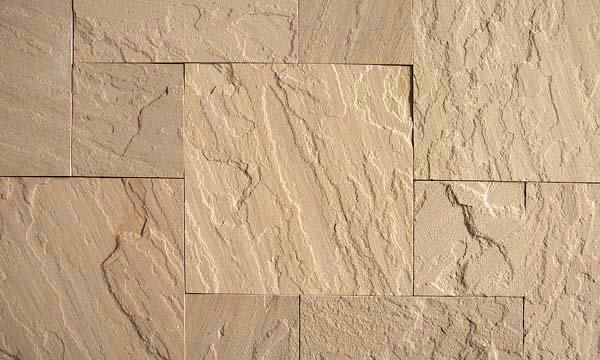 "BEIGE   STONE TYPE: SANDSTONE   TOP FINISH: NATURAL   BOTTOM FINISH: NATURAL OR CALIBRATED   EDGE FINISH: SAWN   DIMENSIONS: 1'X1' TO 2'X3'   THICKNESS: 1"", 1.25"", 2"", 6""   ALSO AVAILABLE IN:  COPING, TREADS, STEPS"