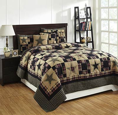 Bring the simple and charming look of the primitive style to your bedroom with the Revere quilt, featuring patchwork squares and stars in striking black and tan, with a touch of red.  This is for the King size quilt set.