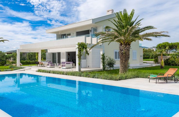 Amantina.  A superb combination of contemporary chic and comfortably casual, this is a spacious luxury villa in Croatia, with splendid seascapes and a shingle beach just beyond the garden gate