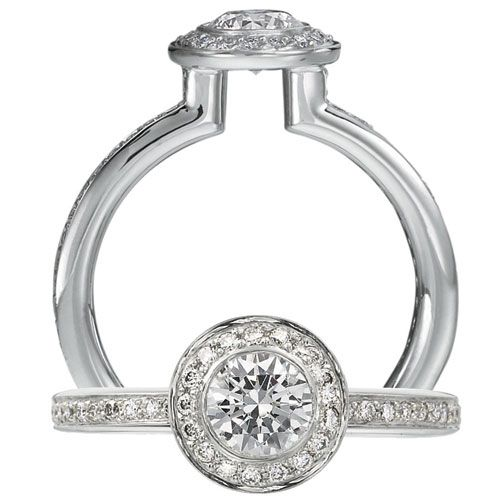 Endless Love Diamond Engagement Ring Featuring A Circular Halo With Bezel Set Round Cut Centerstone