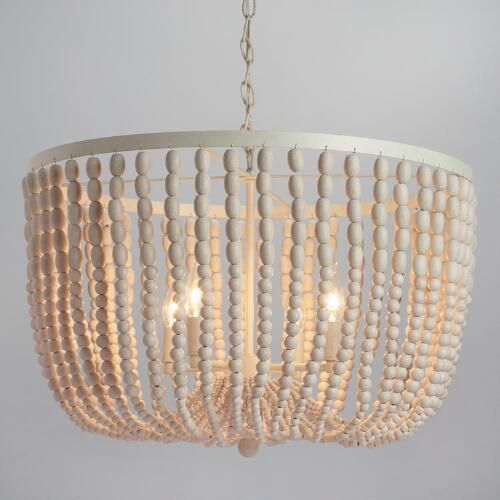 Featuring hundreds of whitewashed round wood beads cascading in dozens of strands, our four-light chandelier is a dramatic statement piece that adds an organic grandeur to the dining or living room.