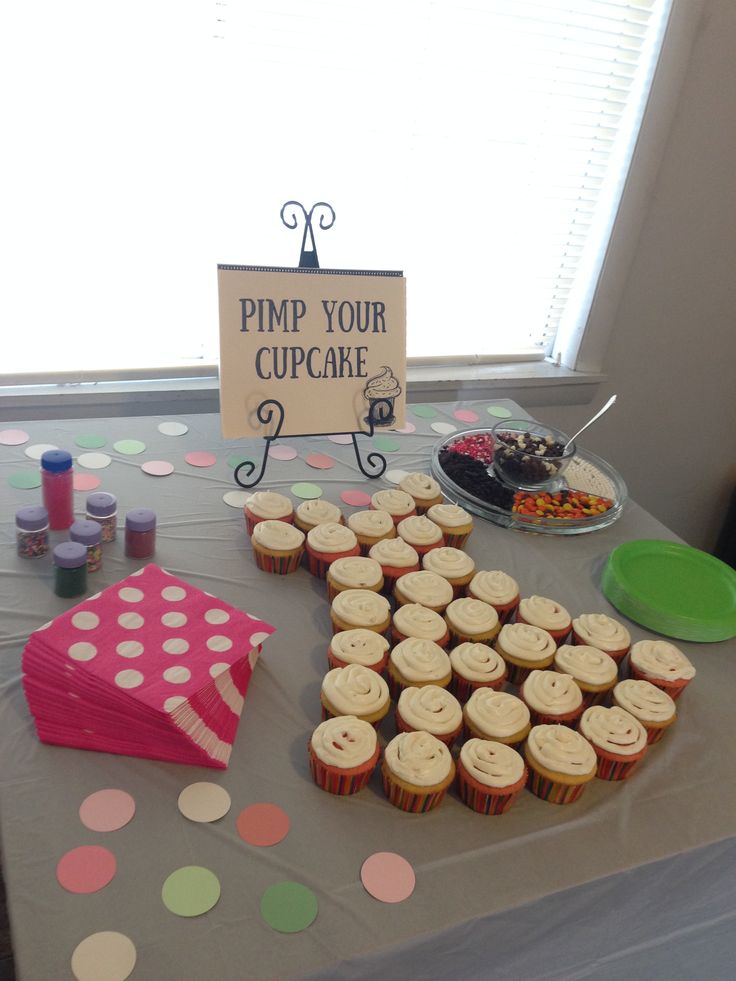 Bridal shower food and decorations on a budget. Cupcake bar and cupcake dress.