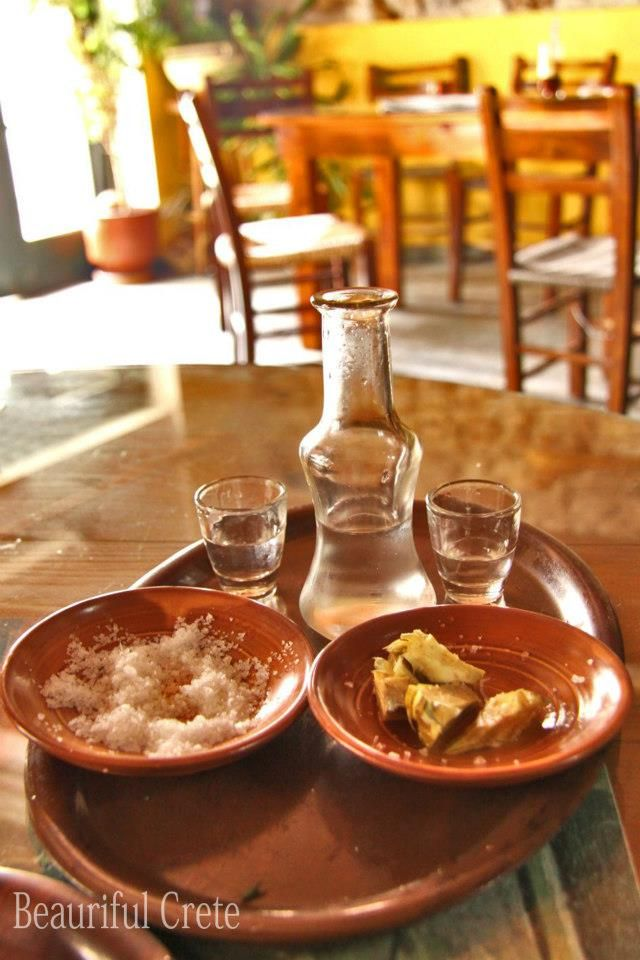 Tsikoudia ,raw artichokes and sea salt ,lemon and olive oil ! That's Creta .....