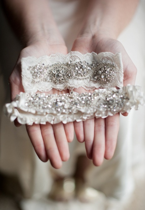 Trousseau    French imported ivory lace embellished with Swarovski crystal jewels.Comes with toss garter adorned with matching crystal jewel. Garter comes in your choice of ivory lace or satin.    Photo Credits | Stacy Able Photography