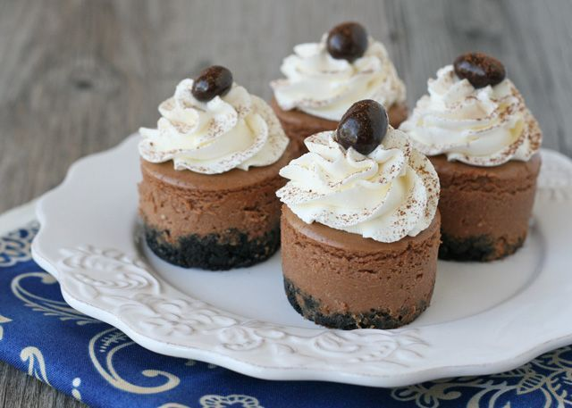 Mini Kahlua Cheesecakes - Crust -  11 Chocolate sandwich cookies (Oreos)  2 Tablespoons butter  Filling -  2 oz. semi-sweet chocolate  12 oz. (1 and 1/2 package) cream cheese  1/4 cup sugar  1 egg  1 teaspoon vanilla  1/4 cup Kahlua (coffee liqueur)