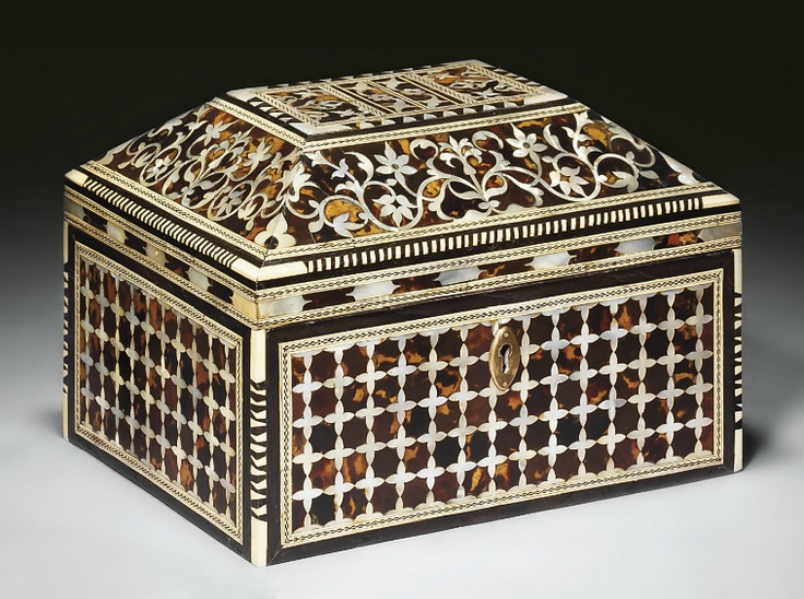 AN OTTOMAN MOTHER-OF-PEARL AND TORTOISESHELL INLAID BOX TURKEY, CIRCA 1800 Of rectangular form with hinged coffered top, each side of the body with panels of quatrefoil motifs forming a lattice design, the lid with wide border of scrolling floral arabesques and the top with four panels, the outer two with mirrored design of palmettes and the inner two with central flowerheads on wide vine, each decorative register within minor border of chequered bone and ebony design