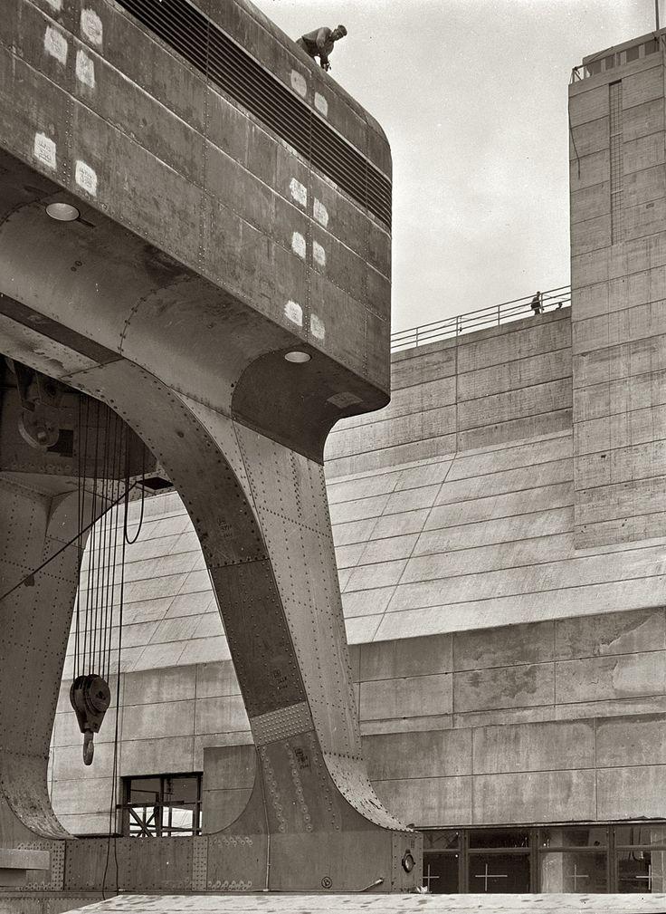 Riveter atop a 250-ton hoist; Cherokee Dam on the Holston River. Photo by Arthur Rothstein, June 1942.