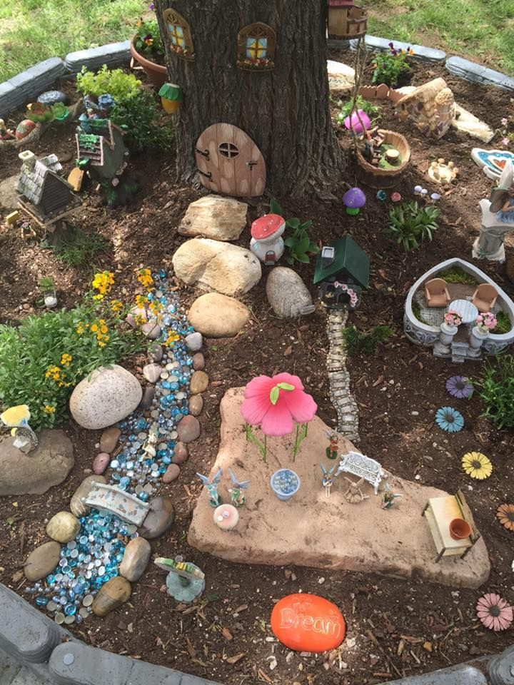Miniature Fairy Garden Under A Tree A Means Of Not Overloading Small Garden Spaces Is The Monochrome D In 2020 Fairy Garden Miniature Fairy Gardens Fairy Garden Diy