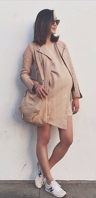 A neutral dress and leather jacket paired with New Balance sneakers